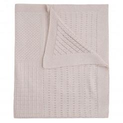 Κουβέρτα μπεζ αγκαλιάς πλεκτή διάτρητη διπλωμένη